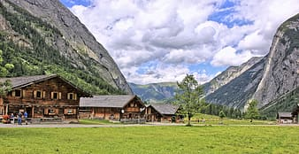 Several wooden houses near mountains