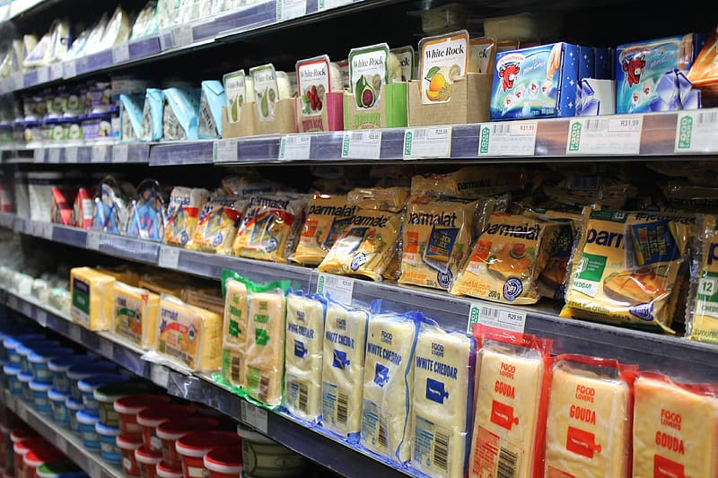 Gondola shelf filled with varieties of cheese products