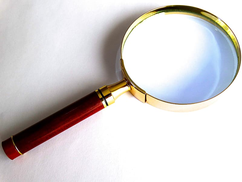 Brown handled magnifying glass