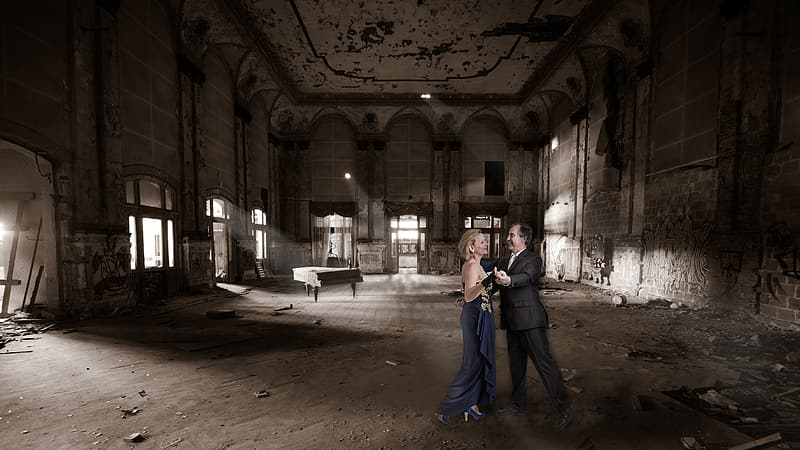 Man and woman dancing inside empty room