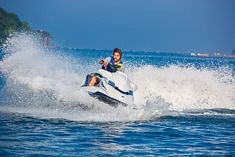 Man riding on personal water craft on body of water