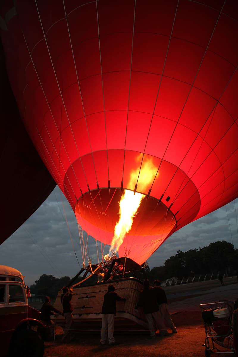Red hot air balloon during daytime
