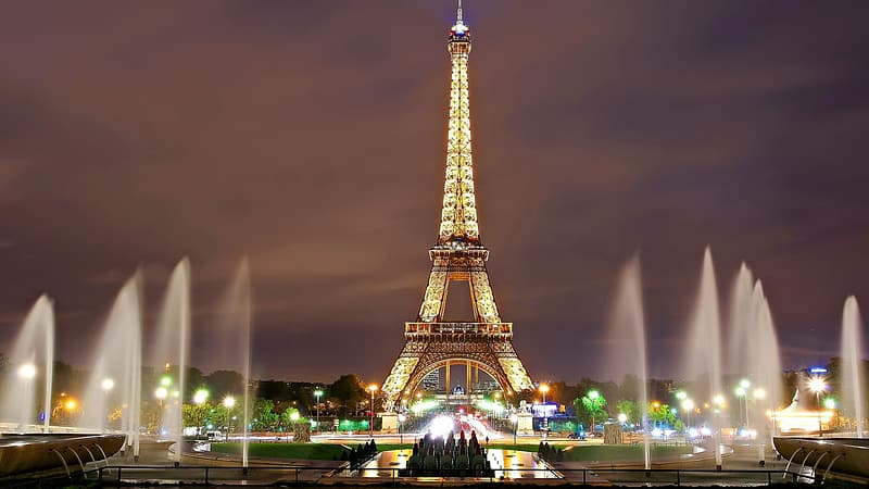 Photo of Eiffel Tower, Paris with water fountains during night time