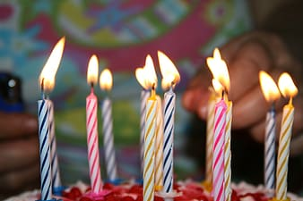 Selective focus photography of lighted cake candles