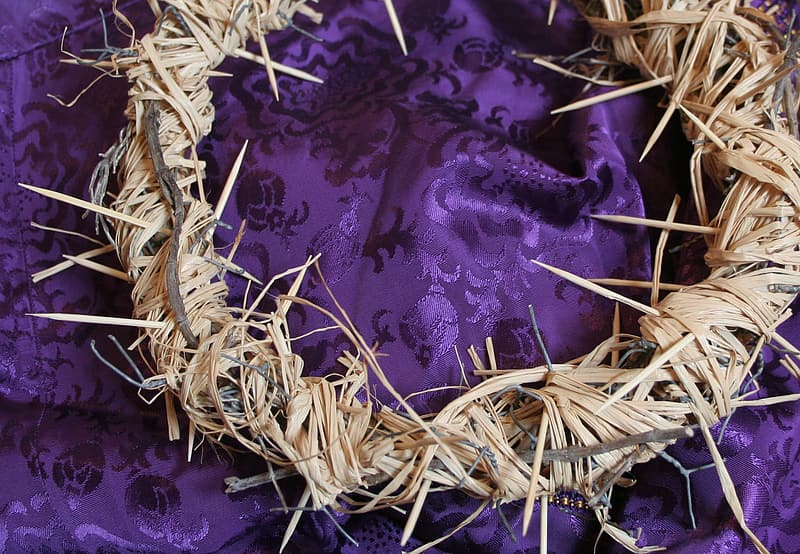 Brown wreath on purple textile