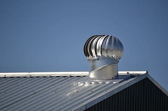 Silver roof turbine on roof