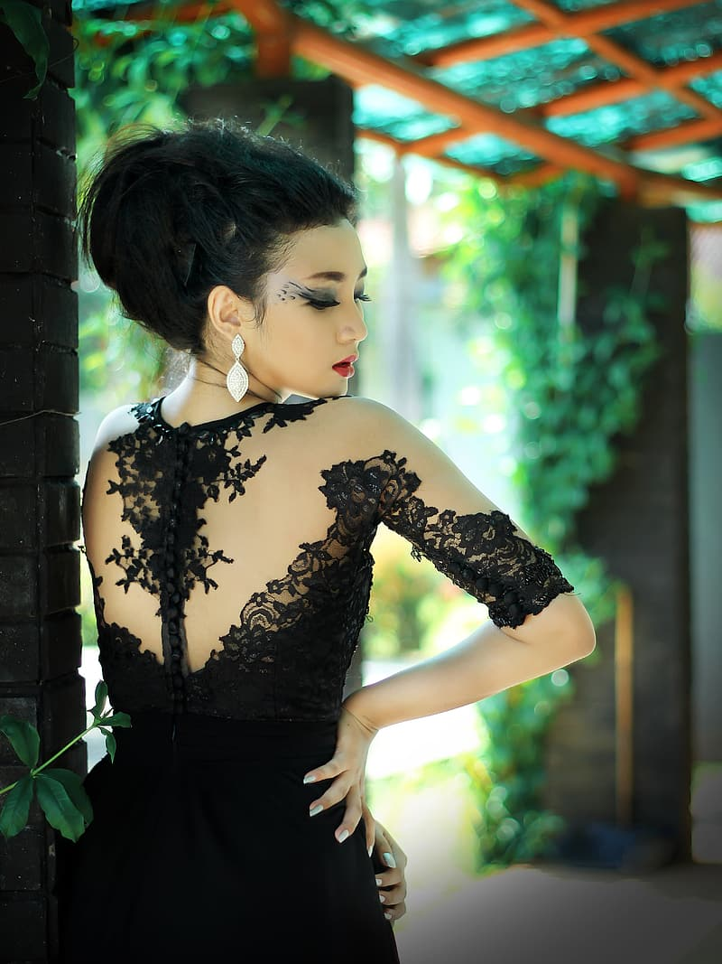 Woman in black long-sleeved gown