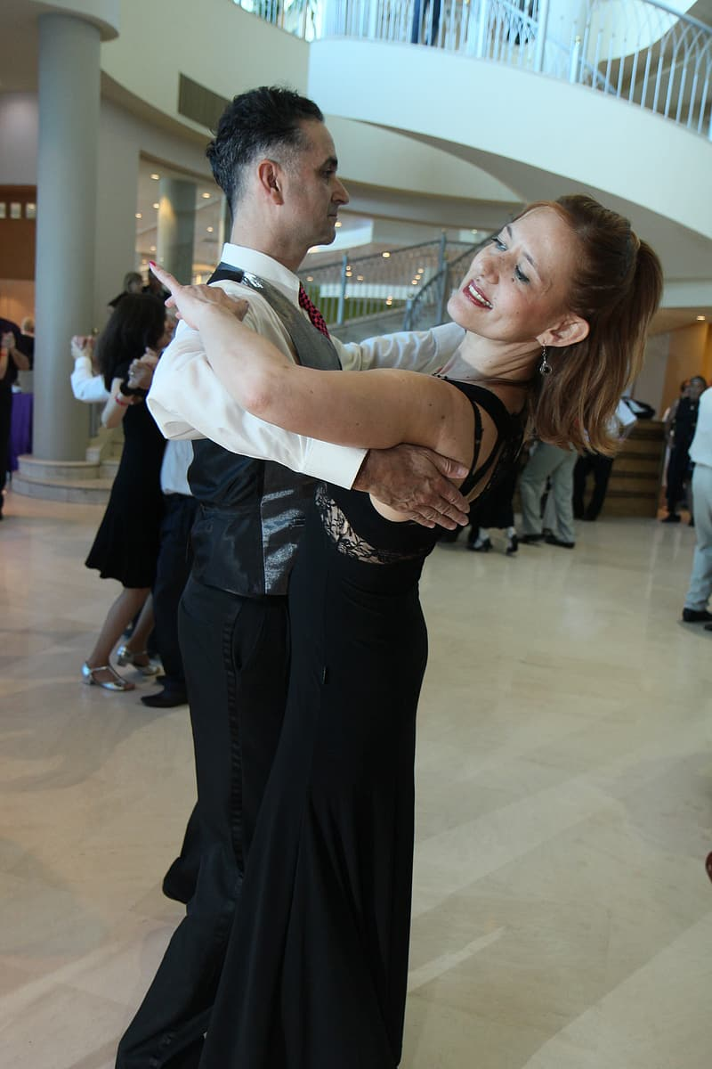 Man and woman dancing in white hall