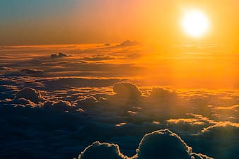 High-angle photography of clouds and sun