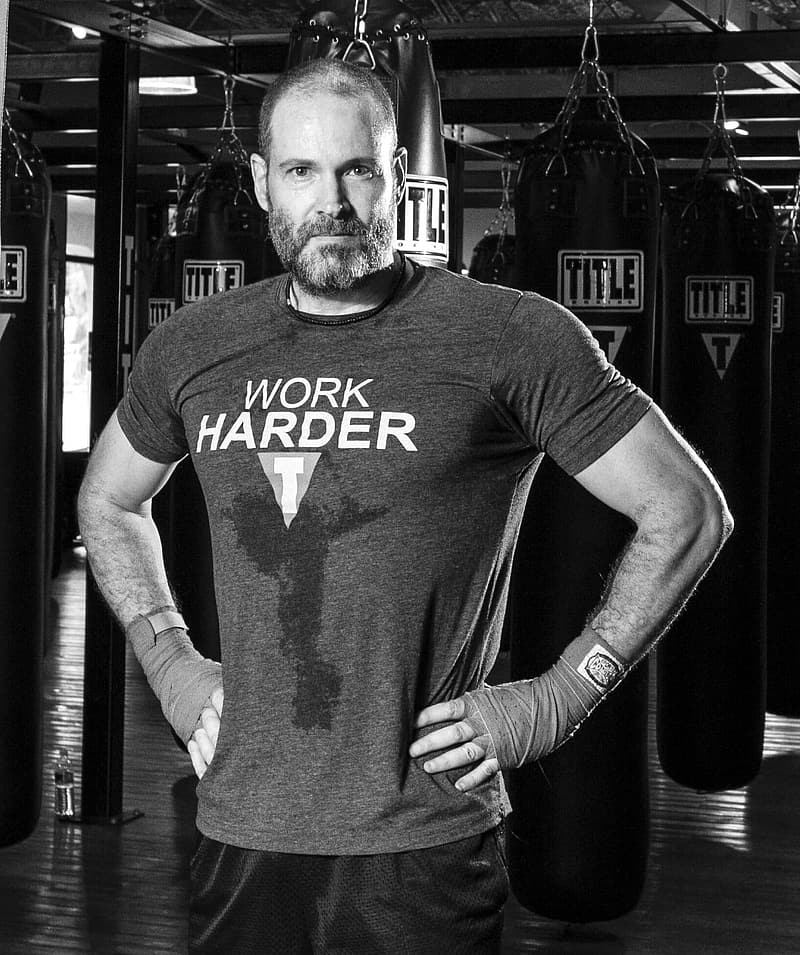 Grayscale photo of man in gym
