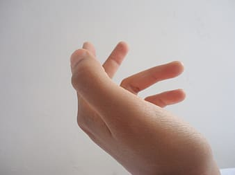 Persons left hand doing peace sign
