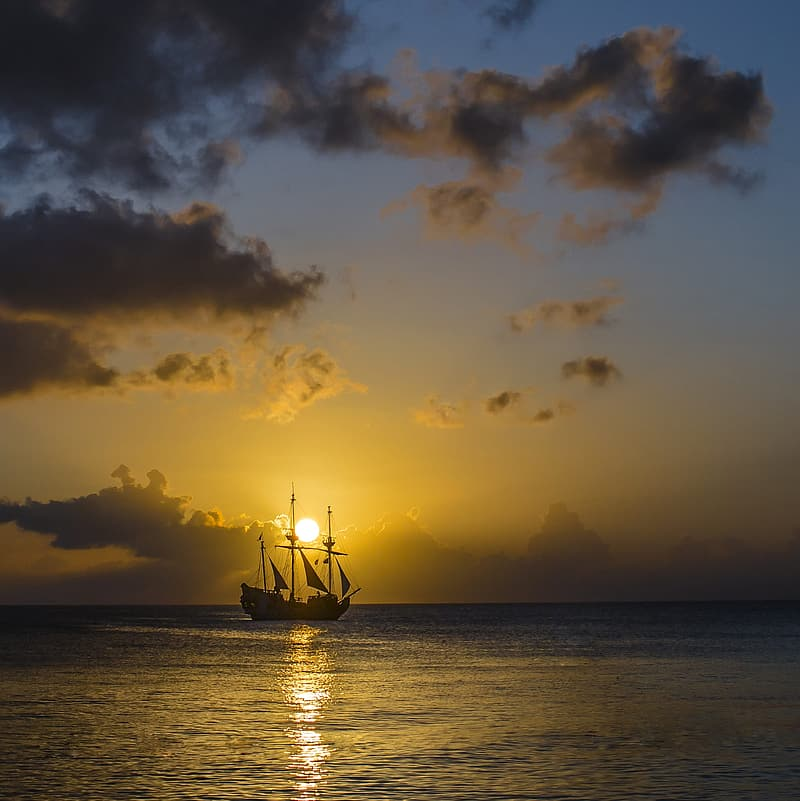 Silhouette of galleon ship at sunset