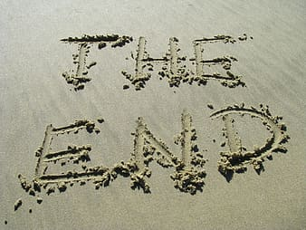 The end text written in the sand