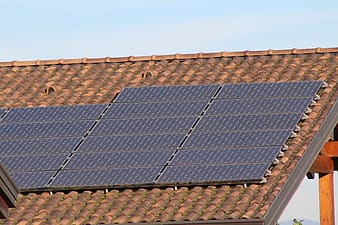 Brown roof shingles installed with solar panels