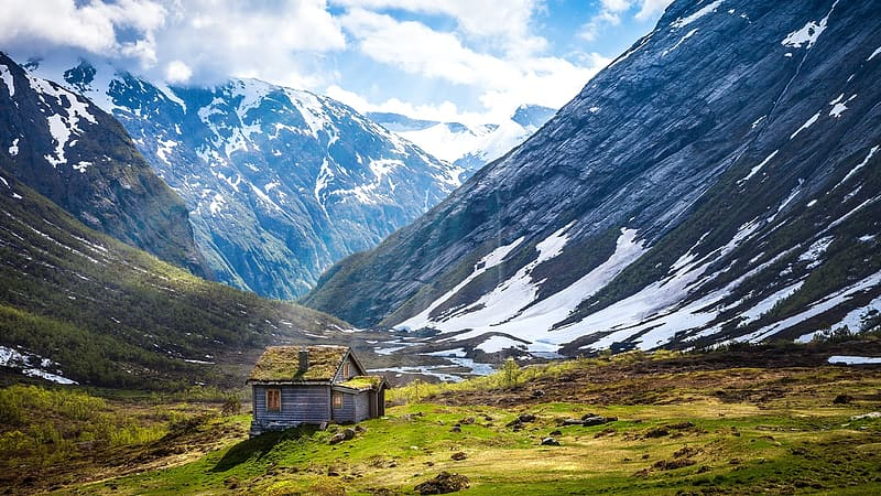 Gray and green house on mountain