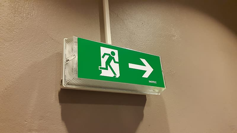 Green and white signage on wall