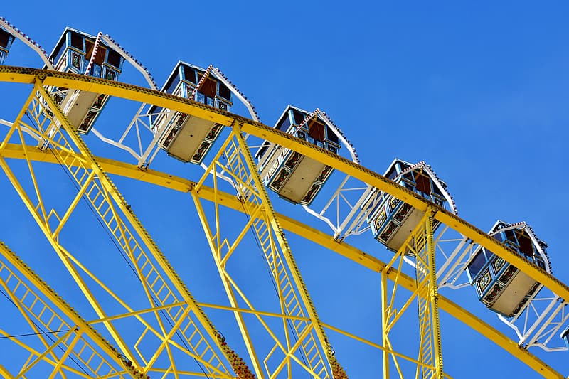 Yellow and white ferris wheel under blue sky during daytime
