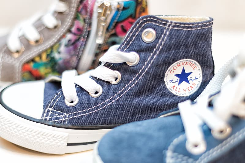 Person wearing blue converse all star high top sneaker