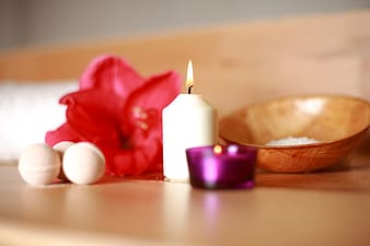 Shallow photography of white candle on table