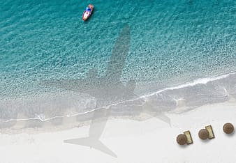 Silhouette of airplane on beachside
