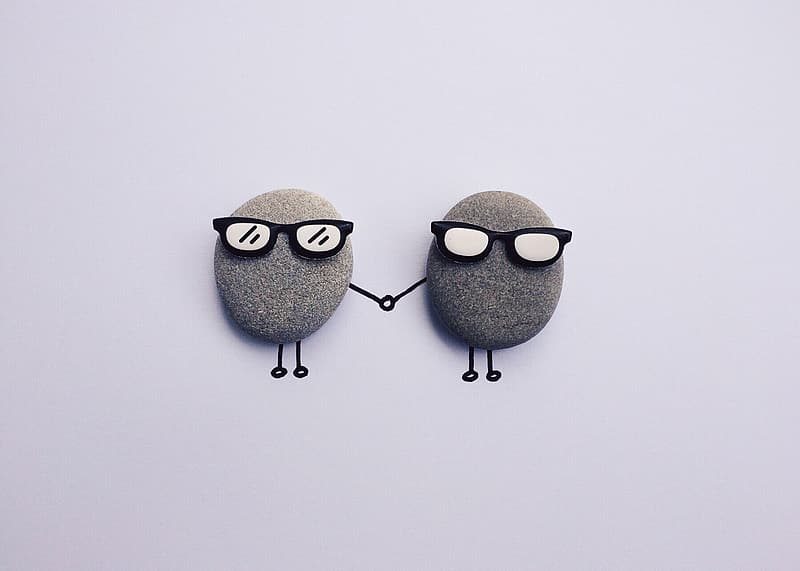 Two gray wall decor with sunglasses