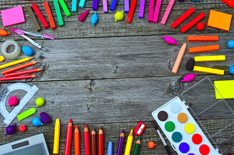 Multi color coloring pencils on brown wooden surface