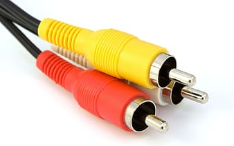 Red, yellow, and white aux cable close-up photography