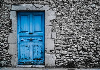 Blue wooden 4-panel door close