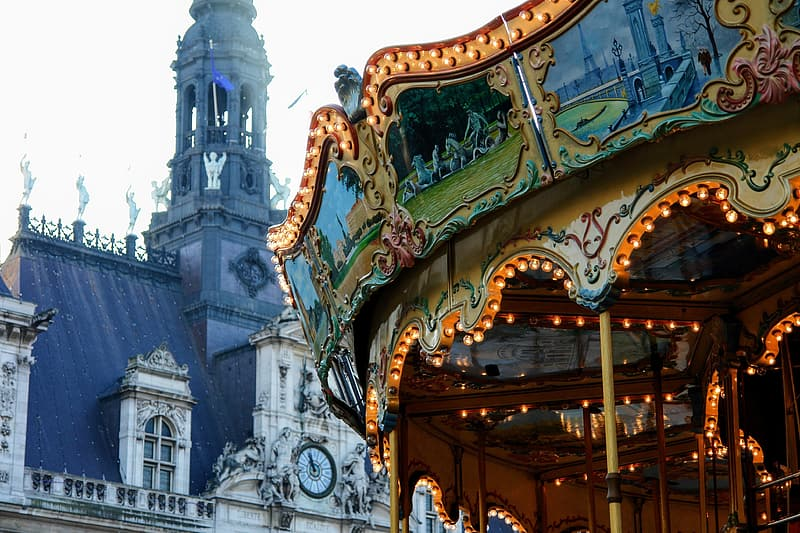 Carousel behind white painted baroque building