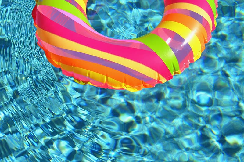 Pink inflatable floater on water