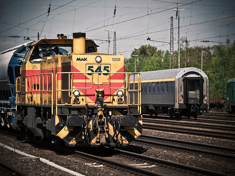 Yellow and red train on rail