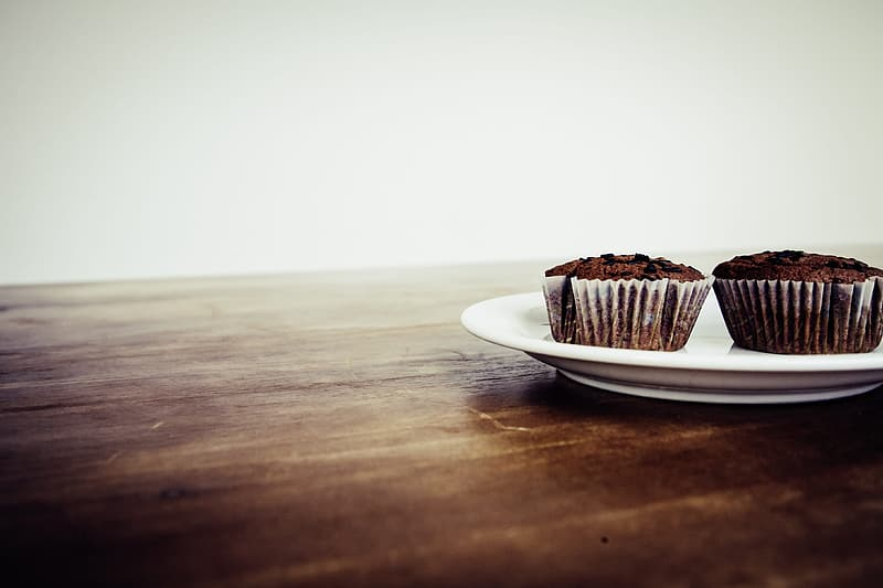 Brown and white chocolate cake on white ceramic saucer
