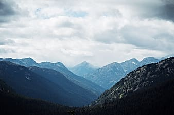 Photography of mountains during cloudy skies