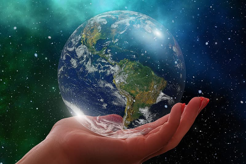 Person holding blue and green planet earth
