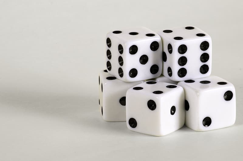 Five white-and-black dice close-up photo