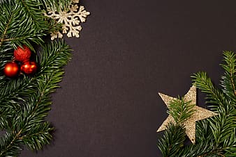Christmas tree with star and red bauble decor