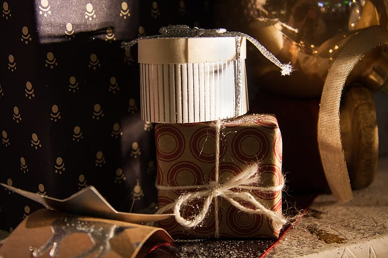 Brown and white gift box with white ribbon