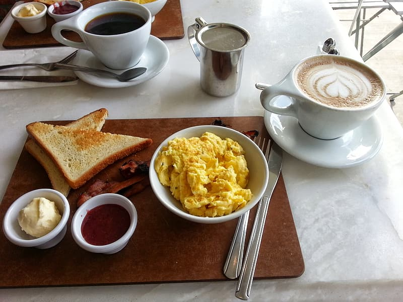 Scrambled egg with bread toast and caffe latte
