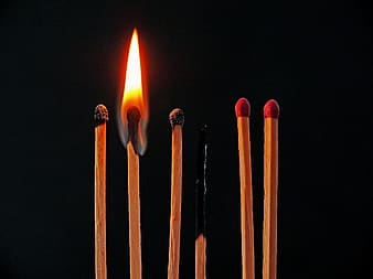 Four black and two red matchsticks