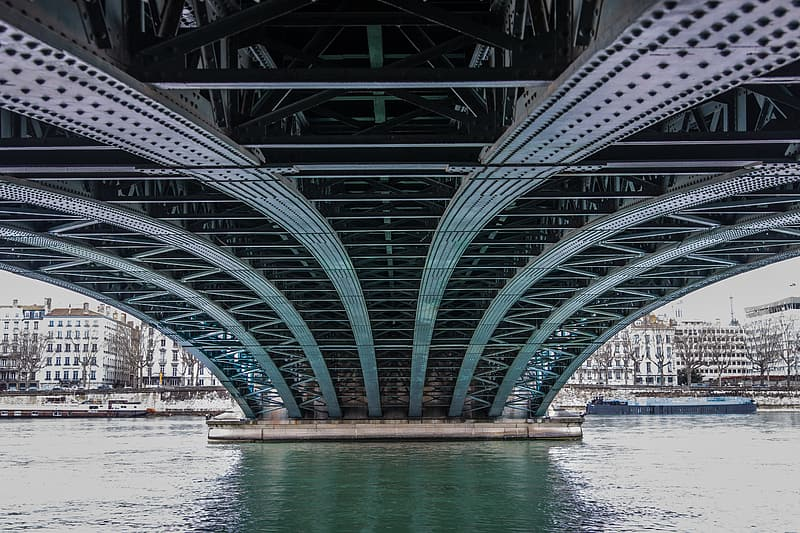 Architectural photography of gray metal bridge