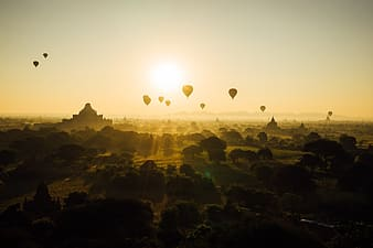Hot air balloons flying during sunset