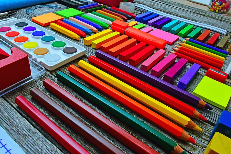 Red blue green and purple coloring pencils