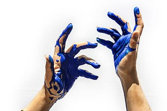 Hands with blue paint