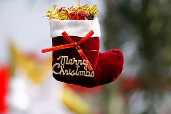 Selective focus photography of red and white Christmas stocking