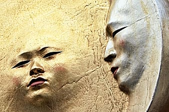 Embossed human faces