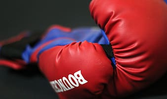 Selective focus photo of red boxing gloves