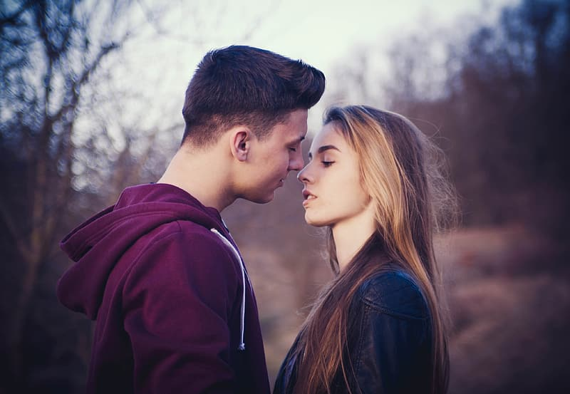 Selective focus photo of man and woman about to kiss