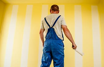 Man in blue dungaree pants