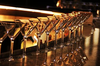 Clear martini glasses on table top
