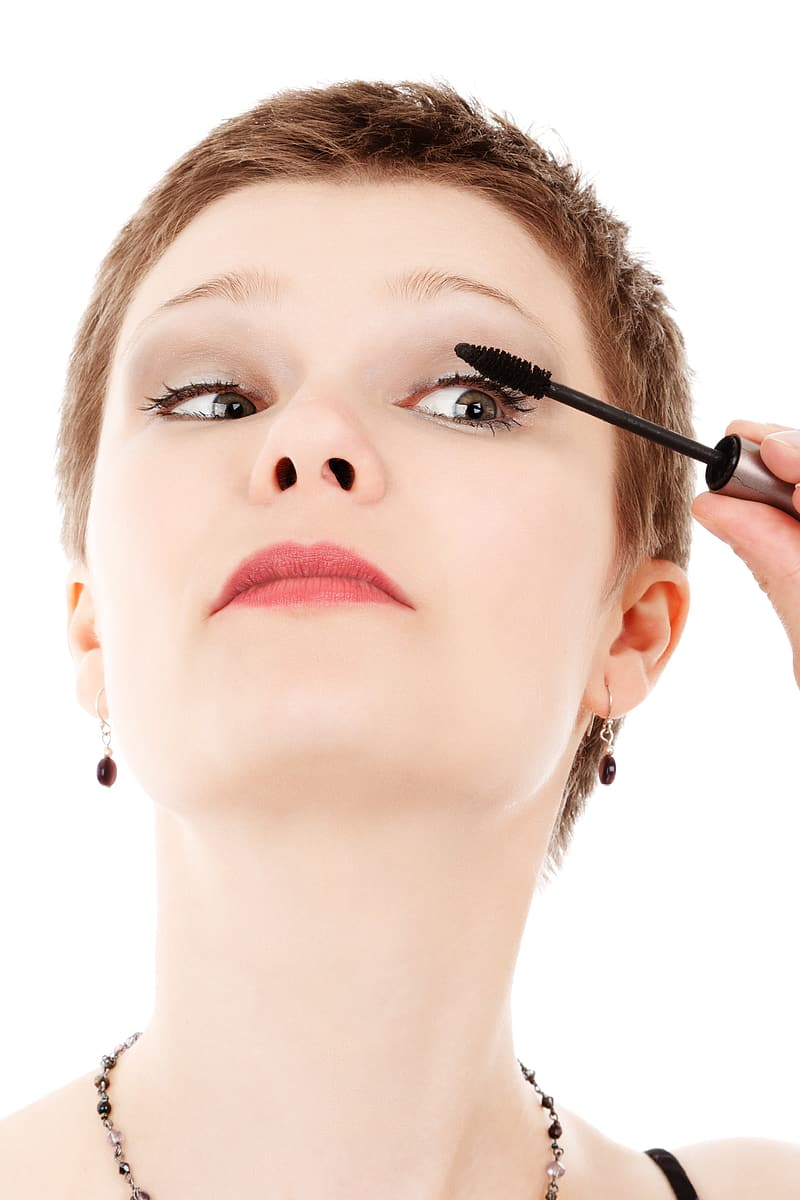 Woman holding mascara